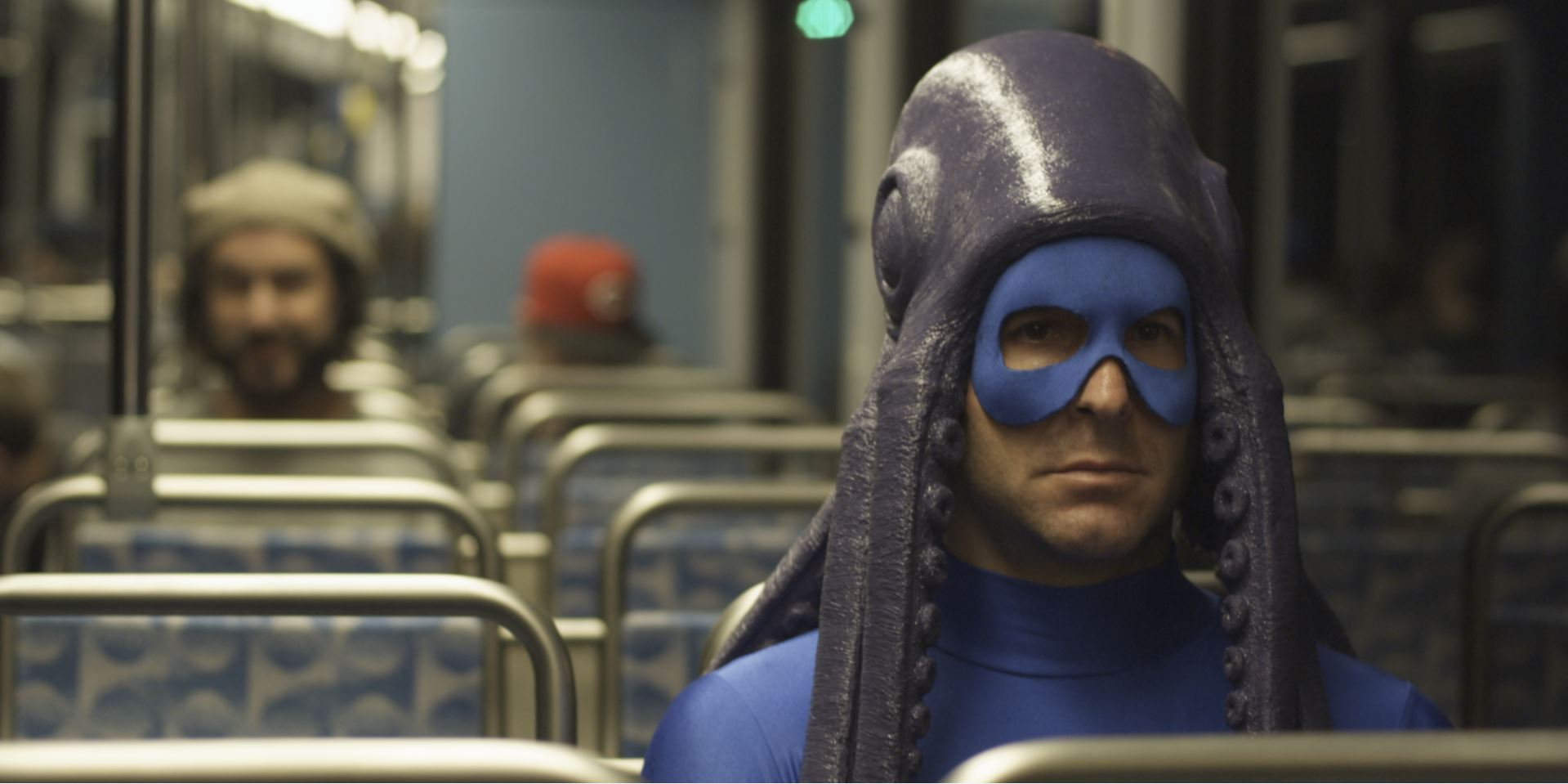 Squid Man on the Train